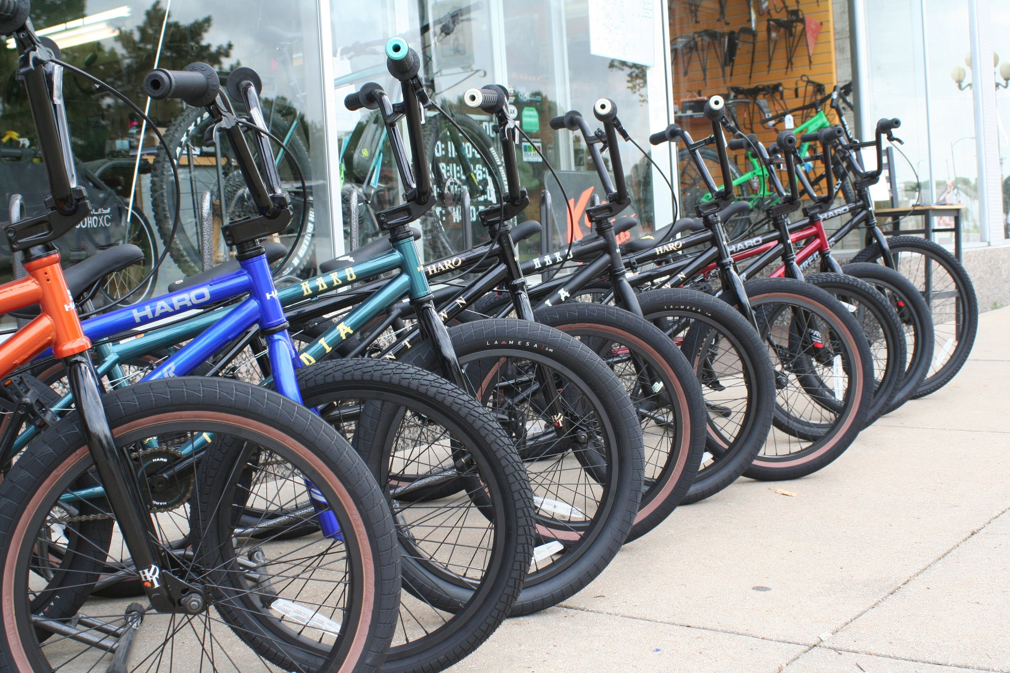 Photo of BMX bikes on sidewalk in front of Southwind Cycle and outdoor.